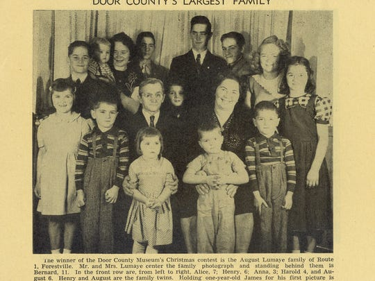 Door County Museum curator Harry Dankoler held a contest for the museum's 10th anniversary to find the largest family in the county. August LuMaye and his wife posed for the paper with the 14 of their 21 children who were still living at home in Forestville.