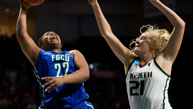FGCU's China Dow (22) shoots over Miami's Emese Hof (21) during the second half of action during a first round NCAA tournament game at the Watsco Center Saturday, March 18, 2017 in Coral Gables, Fla. FGCU would lose to Miami 62-60 in a game that went to the final seconds.