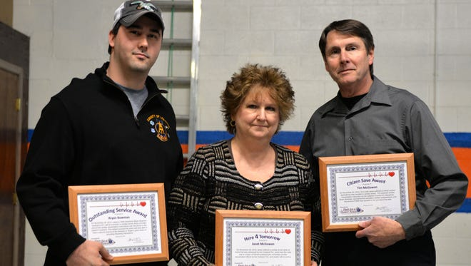 First Aid and Safety Patrol of Lebanon honored several people Feb.  22, 2016, at its Here4Tomorrow program at its main headquarters at 254 S. 11th St., Lebanon. Lebanon County EMA Dispatcher Bryan Bowman, from left, Janet McGowan and her husband, Tim, hold the awards they received. Janet suffered a cardiac arrest on the evening of Nov. 30, 2015. Bowman provided pre-arrival instructions to her husband, who delivered chest compressions until the ambulance crew arrived. Janet was discharged from WellSpan Good Samaritan Hospital seven days following the incident. The program is an opportunity for FASP to recognize the 911 telecommunicators and the bystanders who provided pre-arrival CPR to individuals who have suffered a cardiac arrest.