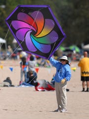 Kites Over Lake Michigan attractions feature giant show kites, precision stunt kite teams, colorful ground displays, kite demonstrations and children's activities.