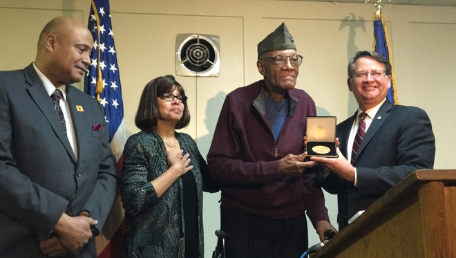 John Jordan, 90, was honored for his World War II service Monday by U.S. Sen. Gary Peters (right) at the Groves-Walker American Legion Post 346 in Farmington. He's seen here next to his daughter Beverly Jordan-Murphy, 65, and son Tracy Jordan, 58.