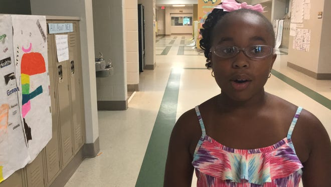 Jasmine Richardson, a 9-year-old rising fourth grader, talks about what the Brain Forest Summer Learning Academy meant to her on Wednesday, July 13, 2016, at Carver High School.