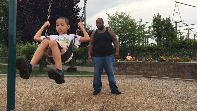 Edward Batts of Nanuet pushes his 5-year-old son, Junior, on the swing at Peck's Pond in West Haverstraw.