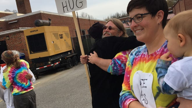 A voter gets a hug from Kelly Miller in front of Bessie Weller Elementary on Election Day.