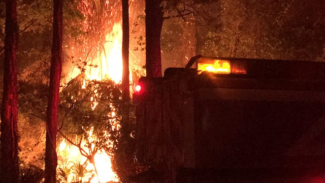 Jill Ruhl-Bolding captured these photos of the fire bearing down on beach homes on St. George Island.