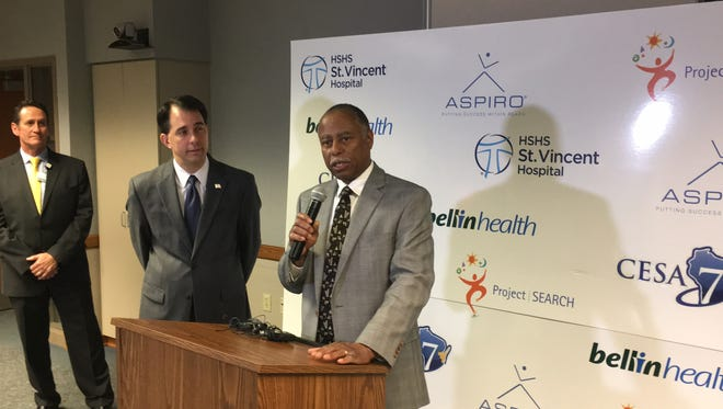 Ray Allen, secretary of the Department of Workforce Development, speaks at HSHS St. Vincent Hospital while Gov. Scott Walker stands by.