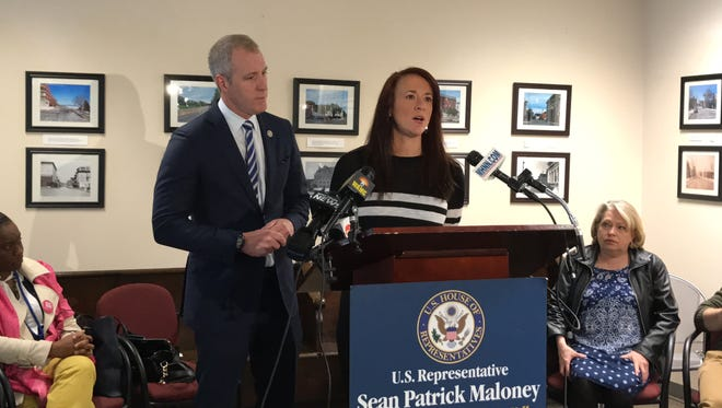 Andria McKenna, whose special needs daughter attends a Kingston-based school, speaks about her fears and anger over the GOP health care bill, at a press conference with Rep. Sean Patrick Maloney, D-Cold Spring, on Monday in Newburgh.
