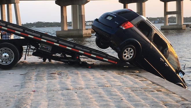 A Nissan Quest minivan that had been submerged in the Indian River by its driver was pulled from the water Saturday.