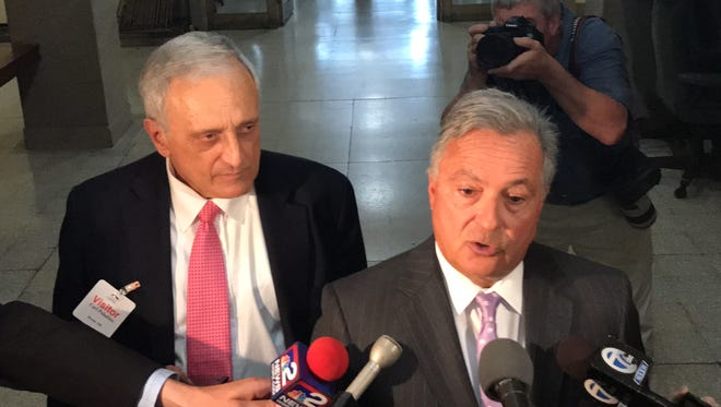 Carl Paladino, left, and his attorney, Dennis Vacco, address the media Thursday during a break in a marathon hearing on Paladino's future.