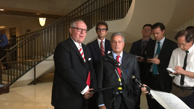 From left, East Aurora-based political consultant Michael Caputo, a former adviser to President Trump's 2016 campaign, speaks to reporters on July 14 in the U.S. Capitol after testifying before the House Intelligence Committee during a closed-door hearing focused on Russian meddling in the election. Also pictured, beside Caputo, is his attorney Dennis Vacco, New York's former attorney general.