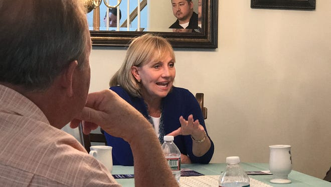 Lt. Gov. Kim Guadagno discusses New Jersey's property tax crisis with township officials and supporters in Manchester. Guadagno, a Republican, is running for governor against Democratic candidate Phil Murphy, a former U.S. Ambassador to Germany.