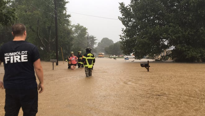 Humboldt Fire and Rescue Squad evacuate families on Mullins Road due to flash flooding in the area Monday, Aug. 28, 2017.