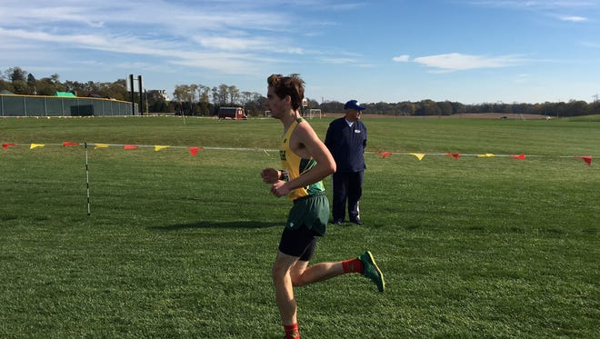York Catholic's Ryan Corbitt runs the final leg of the District 3 Class 1A meet on a left leg he later learned was broken.