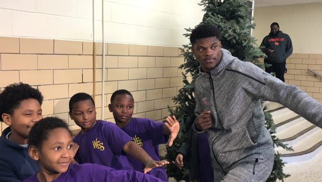 Lamar Jackson taught the Heisman Trophy pose to kids at West End School on Wednesday.