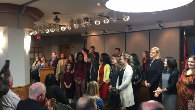 Members of the newly minted Hamilton County Commission on Women and Girls receive a standing ovation upon their appointment Wednesday by the Hamilton County Board of Commissioners