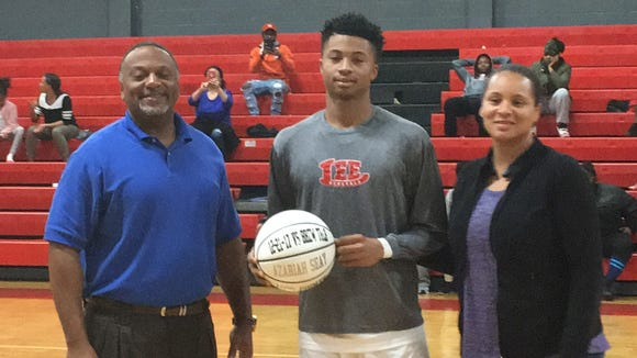 Robert E. Lee senior guard Azariah Seay, pictured here with his parents, has 1,183 career points after Tuesday's game against Prattville.