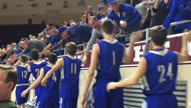 """Walton-Verona players get congratulations from supporters after winning the All """"A"""" semifinal Jan. 27, 2018."""