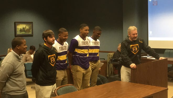 Hattiesburg High baseball team was rated No. 8 in the nation. They will play in a national tournament in March. From left are HHS Athletic Booster Club President Myron Lott, Pitching Coach Brent Barham, players AJ Stinson, Joseph Gray and Dexter Jordan and Head Coach Joe Hartfield.