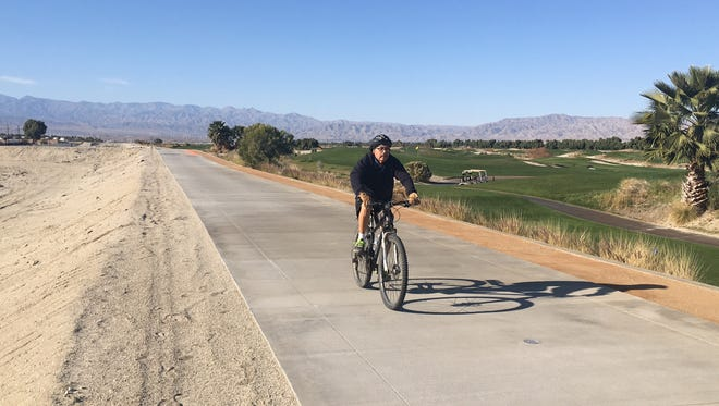 A bicyclist rides along the CV Link in Cathedral City.