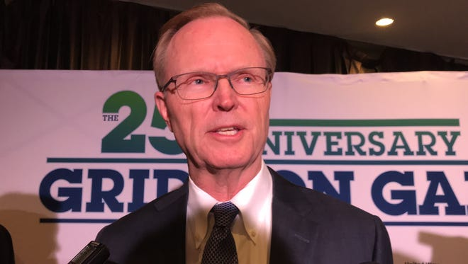 NY Giants co-owner and team president John Mara talks to reporters Tuesday night at the United Way Gridiron Gala at the New York Hilton Midtown in New York.