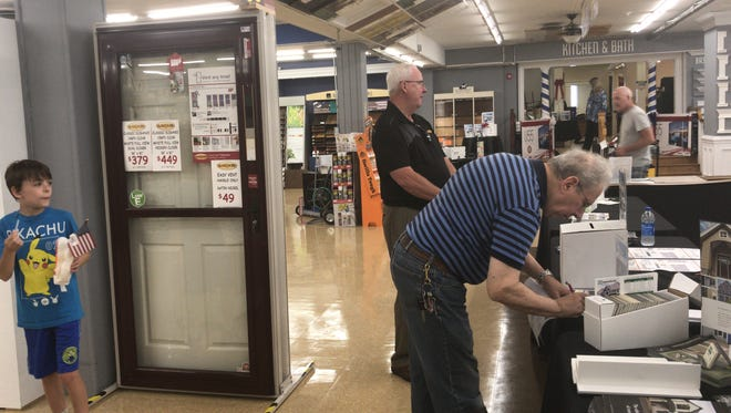 Bob Springer of Bridgewater fills out a vendor sweepstakes at the grand reopening celebration of Somerville Home Center, also of Bridgewater. Spring has been been a customer of Somerville Lumber, now a division of the Home Center, since 1975.