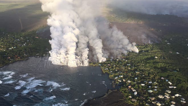 A handout photo made available by the United States Geological Survey shows lava flow originating from Fissure 8 entering Kapoho Bay, Hawaii, on June 4, 2018.