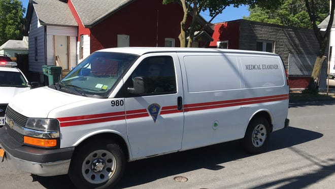 The Monroe County Medical Examiner van arrives at the scene of a fatal motorcycle collision Friday afternoon on Otis Street in Rochester.