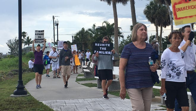 """More than 150 people met near Riverview Park in Sebastian for a Families Belong Together rally on Saturday, June 30, 2018. The rallies were organized across the country to protest the Trump administration's """"zero-tolerance"""" immigration policies."""