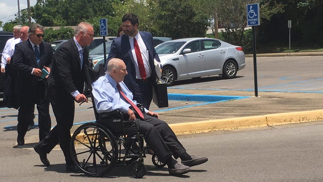 Hattiesburg attorney John Lee is wheeled into William M. Colmer Federal Courthouse for his sentencing on Tuesday, July 17, 2018.