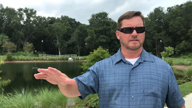 Derrik Owens, project director for the city's renovation at Bill Gregory Park, talks Monday, Julu 30, 2018, about the new stormwater pond.