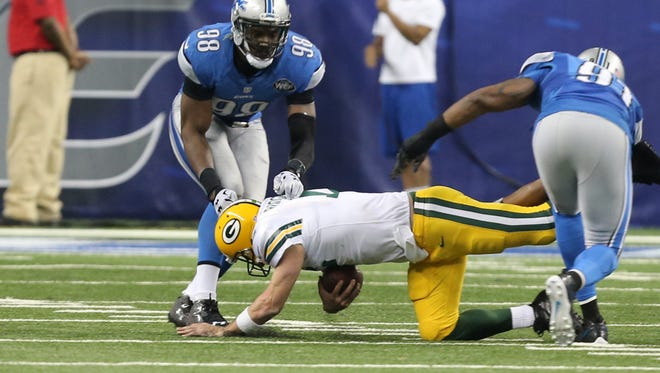 December 3, 2015: After taking a 20-0 lead on Green Bay during a nationally televised game, Aaron Rodgers threw a 61-yard Hail Mary touchdown pass to Richard Rodgers on one final untimed play as the Green Bay Packers rallied from a 20-point third-quarter deficit to shock the Lions at Ford Field, 27-23.  The Lions scored 17 points in the first quarter, but the Packers took advantage of two third-quarter fumbles – one of their own – and a late facemask penalty on Devin Taylor here to set up the final Hail Mary pass.