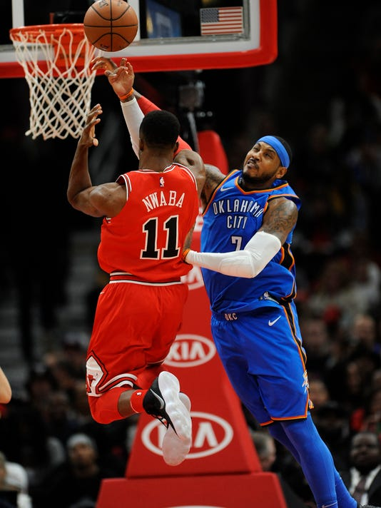 Oklahoma City Thunder's Carmello Anthony (7) fouls Chicago Bulls' David Nwaba (11) during the second half of an NBA basketball game Saturday, Oct. 28, 2017, in Chicago. (AP Photo/Paul Beaty)
