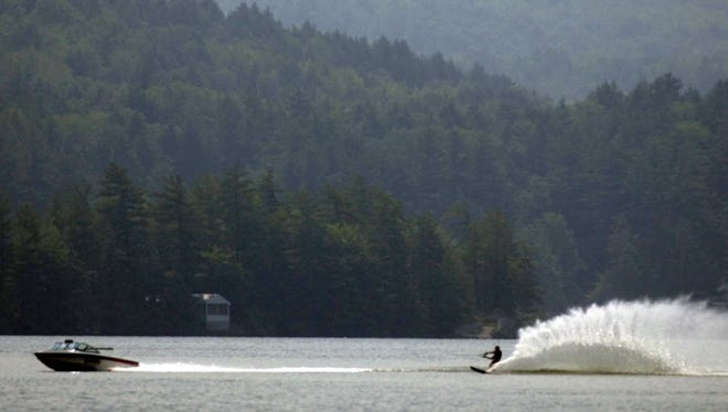 A water skier trails a boat on Lake Iroquois in Hinesburg in 2002. A swimmer was hit by a boat in the lake on Saturday and seriously injured, her husband told the Burlington Free Press on Monday.