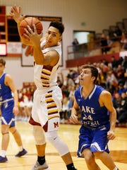 Isaac Angstadt of McCutcheon pulls down an offensive