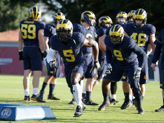 Michigan linebacker Jabrill Peppers (5) runs drills during football practice Tuesday in Miami.