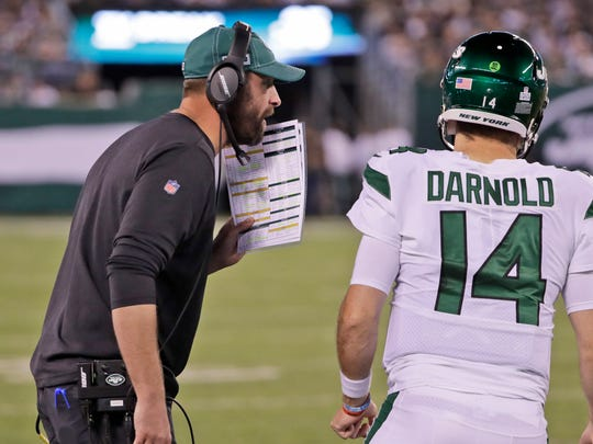 New York Jets head coach Adam Gase, left, talks to quarterback Sam Darnold during the second half of an NFL football game against the Dallas Cowboys, Sunday, Oct. 13, 2019, in East Rutherford, N.J. (AP Photo/Frank Franklin II)