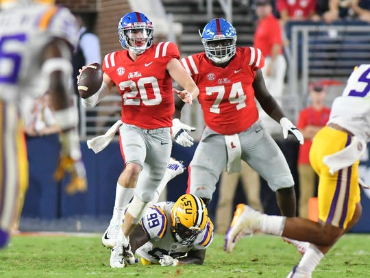 Ole Miss quarterback Shea Patterson (20) moves out