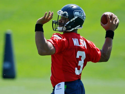 Seattle Seahawks quarterback Russell Wilson passes during NFL football practice, Friday, June 2, 2017, in Renton, Wash. (AP Photo/Ted S. Warren)