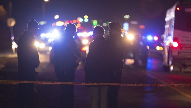 IMPD officers work the scene of an evening shooting that injured a police officer, south of East 38th Street and Mitthoeffer Road, Indianapolis, Thursday, Jan. 15, 2015.