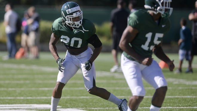Sophomore safety Jalen Watts-Jackson runs drills during a recent practice. Watts-Jackson is coming off hip surgery from an injury that took place as he crossed the goal line to score the winning touchdown at Michigan last October.