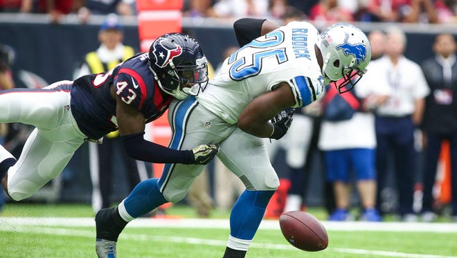 Oct 30, 2016; Houston, TX, USA; Lions running back Theo Riddick is unable to make a reception as Houston Texans defensive back Corey Moore defends during the second quarter at NRG Stadium.