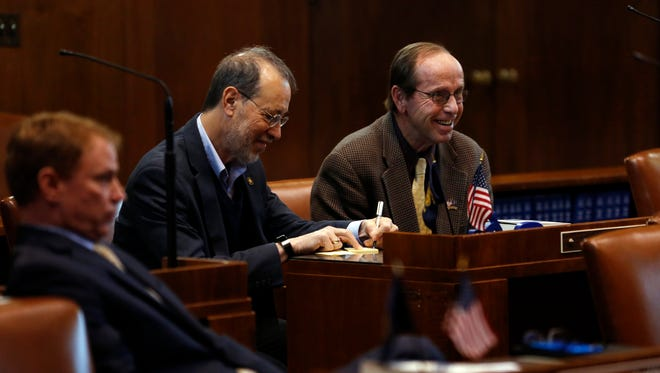 Sen. Jeff Kruse, R-Roseburg, right, laughs with Sen. Michael Dembrow, D-Portland, in the Senate Chamber at the Oregon Capitol Building in Salem, Oregon, Wednesday, Nov. 15, 2017.