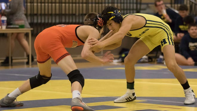 Brighton's Ben Manly (left) and Hartland's Wyatt Nault are ranked at 112 pounds this season heading into the teams' dual meet Wednesday at Brighton.