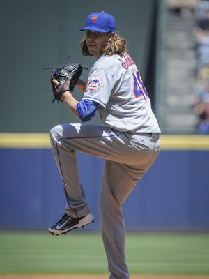 New York Mets' Jacob deGrom pitches against the Atlanta Braves during the first inning of a baseball game on Sunday in Atlanta.