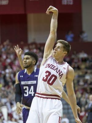 Collin Hartman styles a shot for Indiana as opponent Sanjay Lumpkin watches, Northwestern at Indiana University, Assembly Hall, Bloomington, Saturday, Jan. 23, 2016. Indiana won 89-57.
