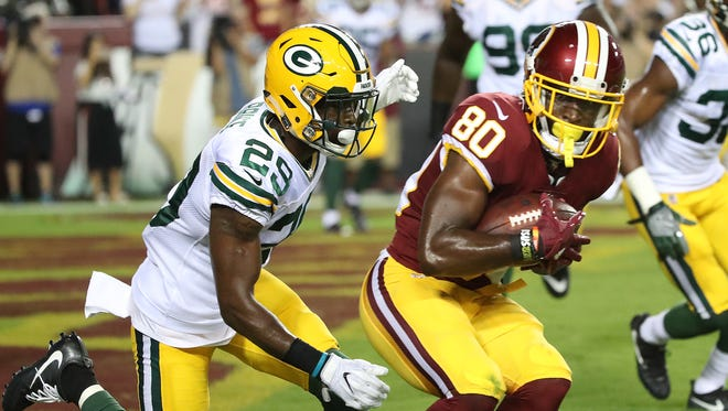 Packers defensive back Kentrell Brice (29) surrenders a touchdown catch to Washington wide receiver Jamison Crowder on Aug. 19, 2017 at Fedex Field in Landover, Maryland.