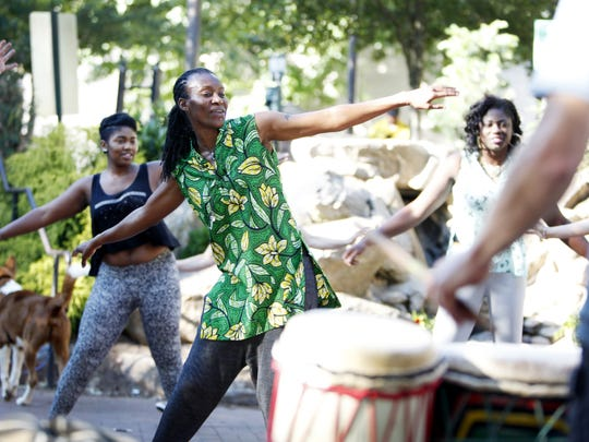 Barakissa Coulibaly, from West Africa, teaches a dance to the beat of drum group Mosso-Kan at Pritchard Park during the LEAF Global Citizens Dance & Art Series Wednesday.