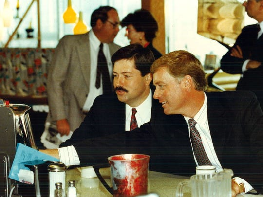 Gov. Terry Branstad and Vice President Dan Quayle look over the selections on a jukebox at Stella's Blue Sky Diner on Sept. 11, 1990 in Des Moines.