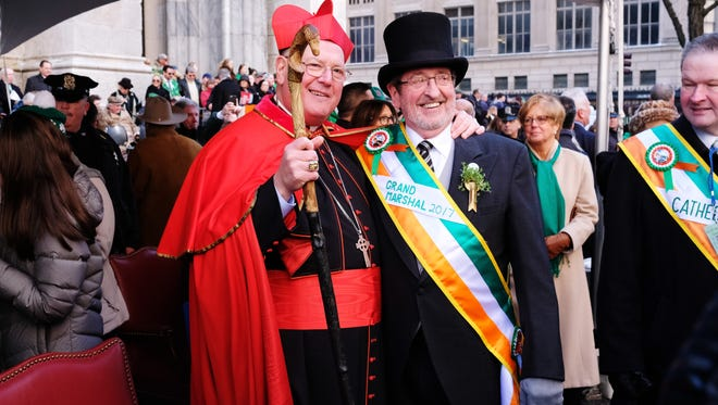 Cardinal Timothy Dolan and Grand Marshal Michael Dowling pose at the St. Patrick's Day Parade in New York City on March 17, 2017.