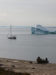 Sailing yacht DAX is anchored at Pond Inlet, Baffin